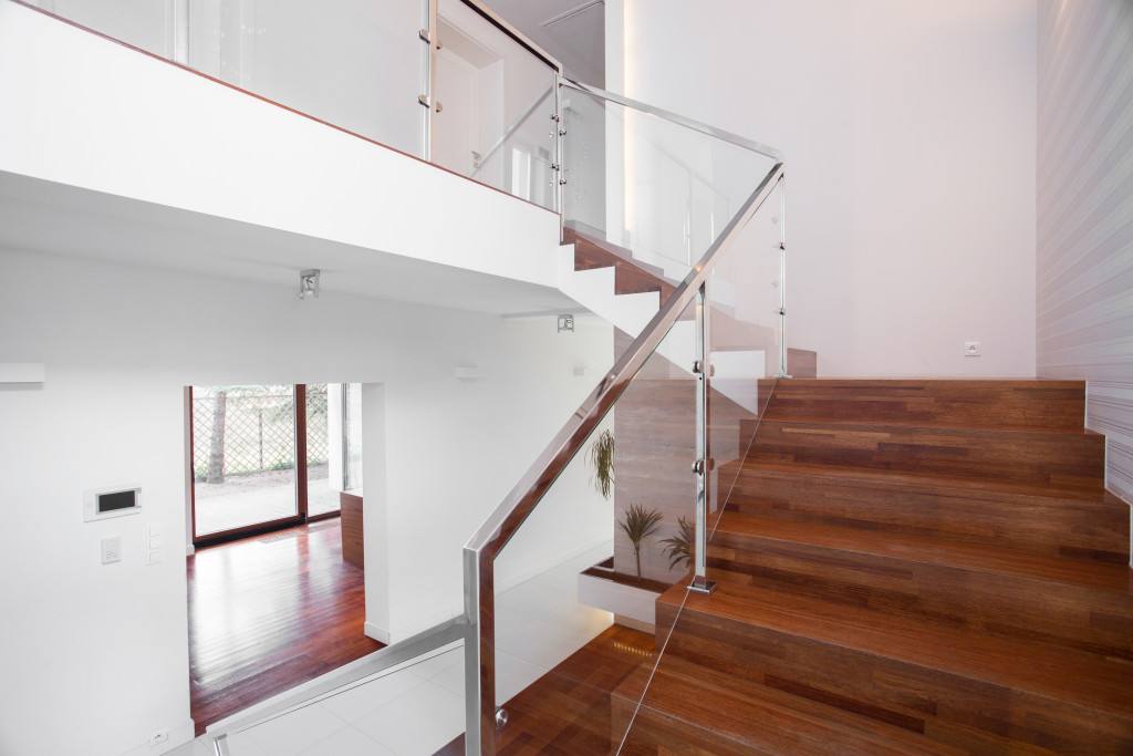 wooden stairs with elegant glass balustrade