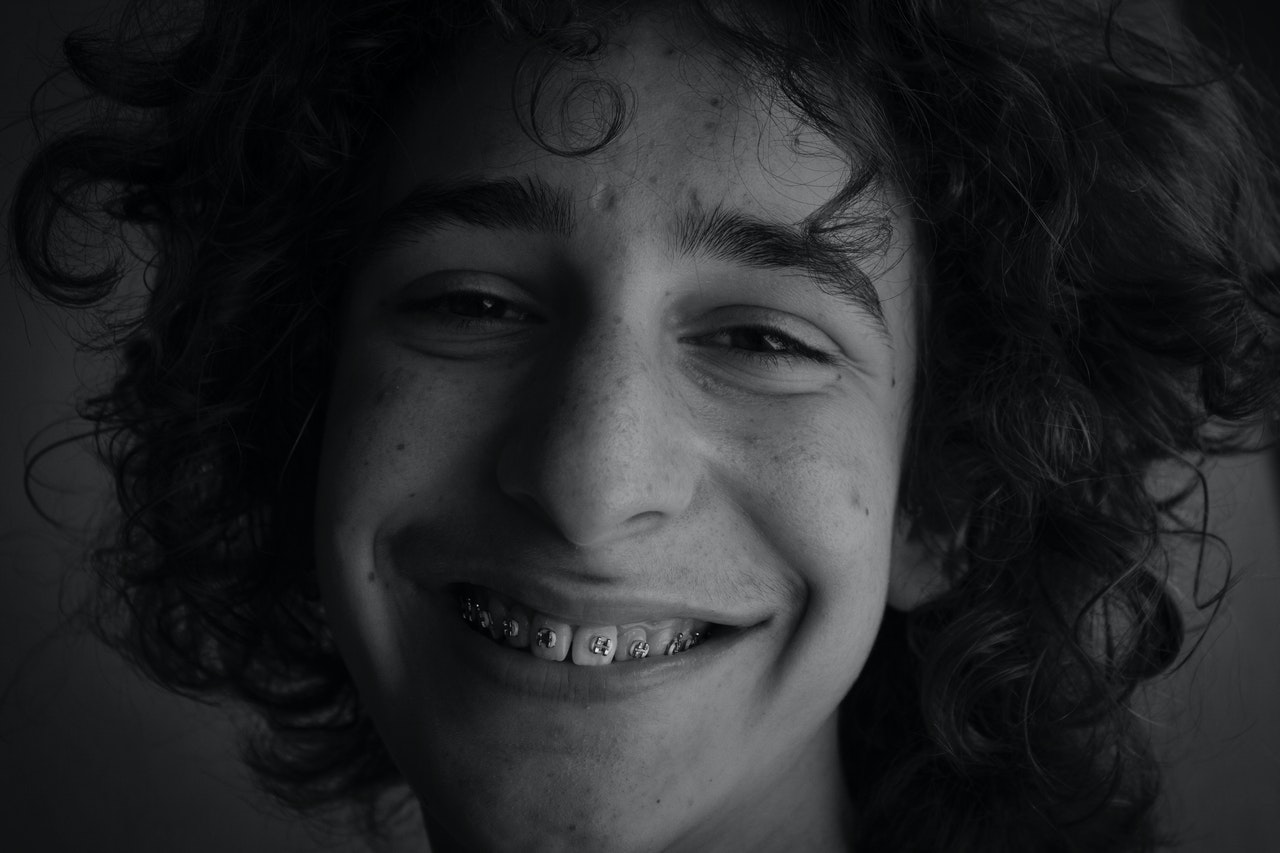 young man with braces