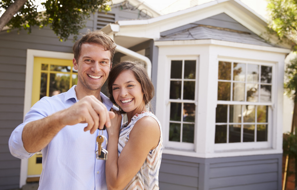 man and woman owning a home