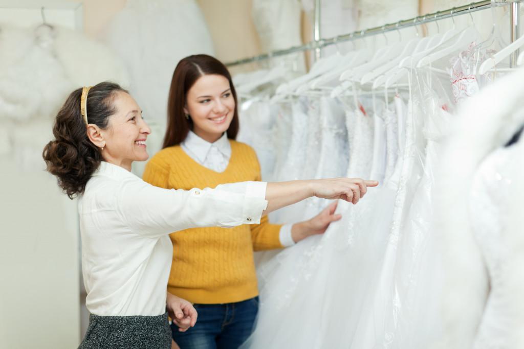 2 women choosing a wedding gown